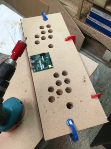 Cutting the control panel holes in the acrylic